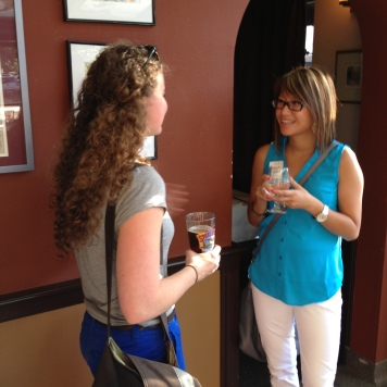 Journalist Morgan Searles and librarian Becca Kwong exchange ideas at the inaugural CapSciComm social.