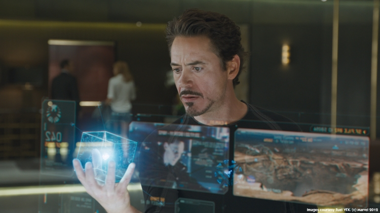 Tony Stark (Robert Downey, Jr.) holds a model of a fictional tesseract in the Marvel movie The Avengers.