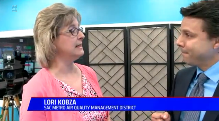 Lori Kobza, spokesperson for the Sacramento Metropolitan Air Quality Management District, presents the new Spare the Air app on FOX40 News (Image Credit: FOX40 News)