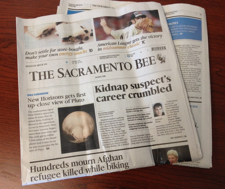 The Sacramento Bee reprints an Associated Press story about space probe New Horizons' flyby of Pluto in its Wednesday, July 15 edition. (Image Credit: Ben Landis)
