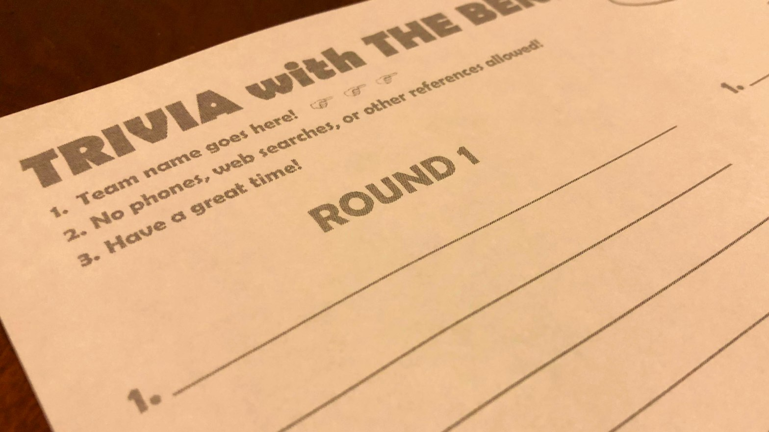 "A photo of a blank trivia answer sheet. The center of the photograph reads ""Round 1"""