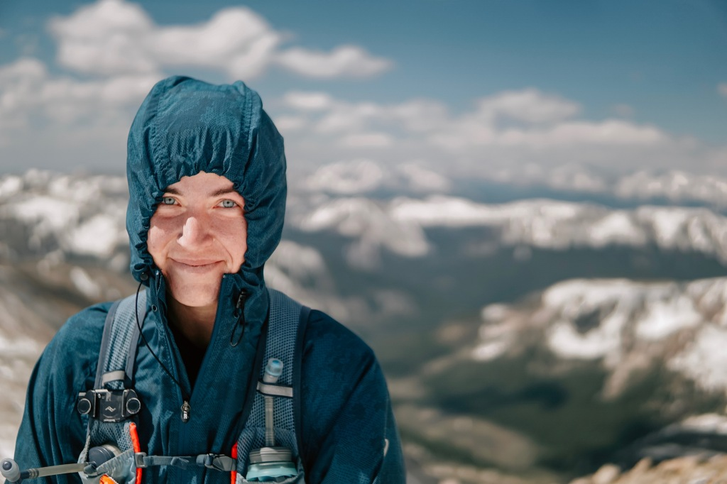 Portrait photo of Patty Bolan on a mountaintop.